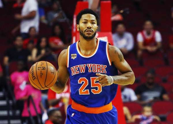 Derrick Rose dribbles up court during his only