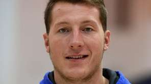 Hofstra forward Rokas Gustys answers questions from the