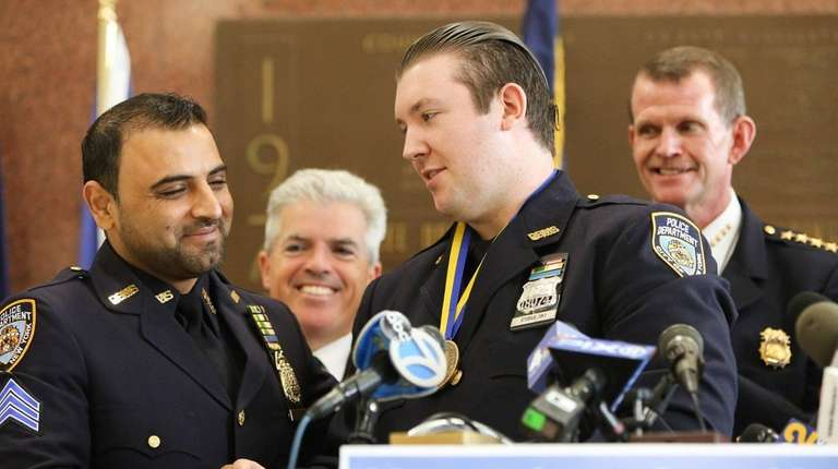 NYPD Police Officer Peter Cybulski of Flanders, right,