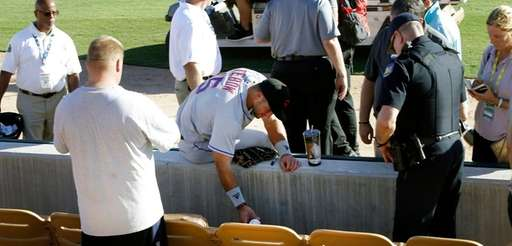 Tim Tebow waits with a fan following Tebow's