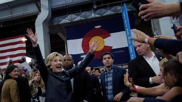 Democratic presidential nominee Hillary Clinton greets supporters after