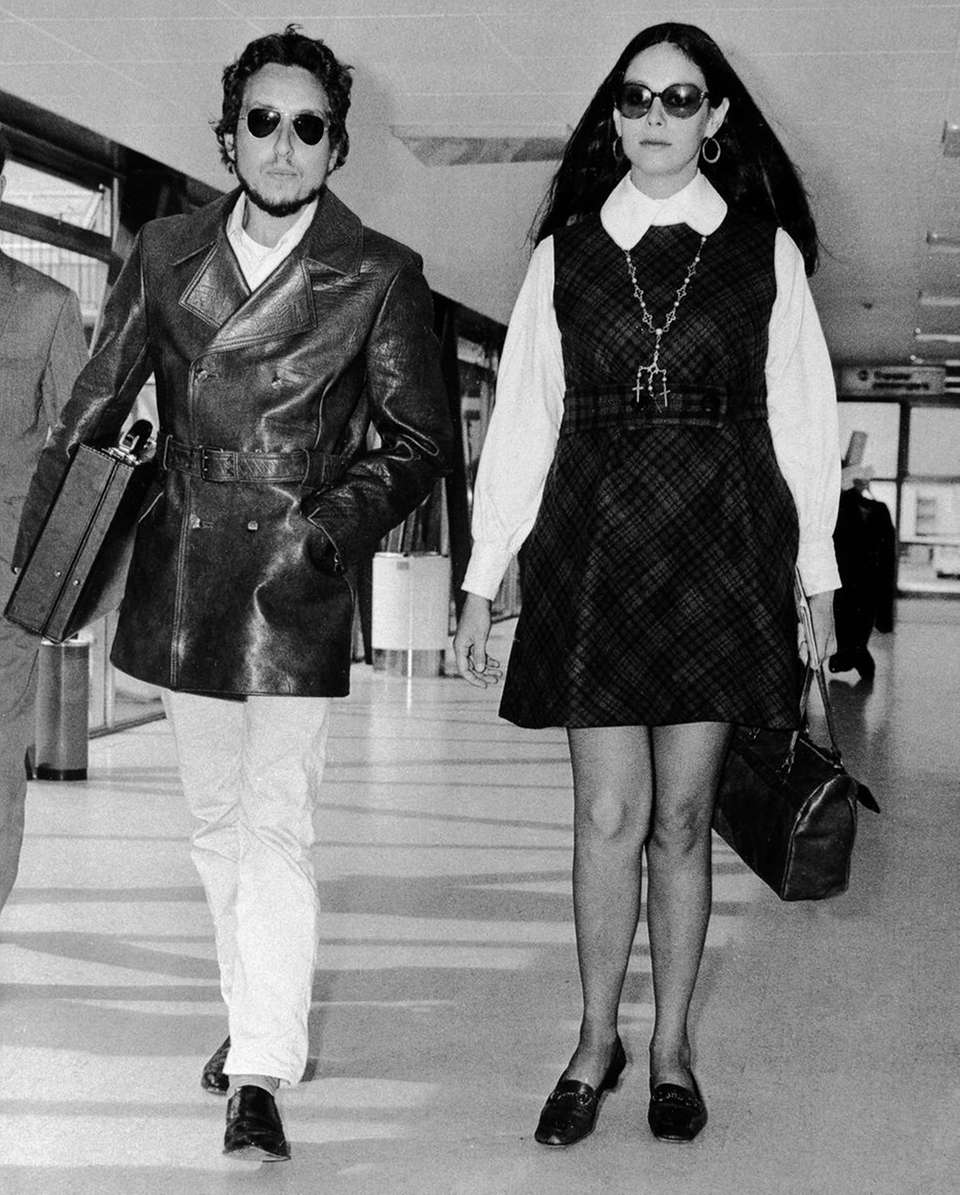 Singer-songwriter Bob Dylan and his wife, Sara, strolling