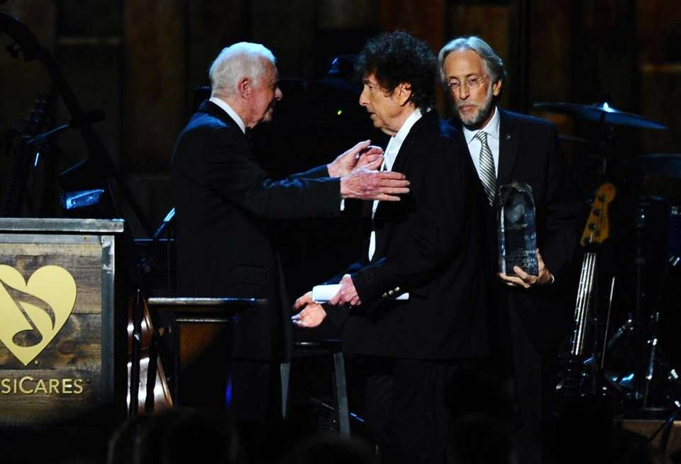 Former President Jimmy Carter presents Bob Dylan with