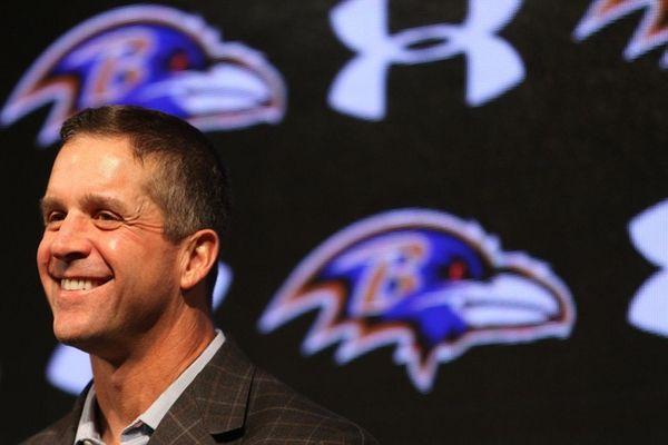 Baltimore Ravens head coach John Harbaugh laughs during