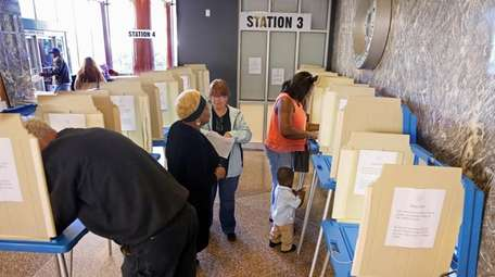 Voters cast ballots in Milwaukee on Sept. 26,