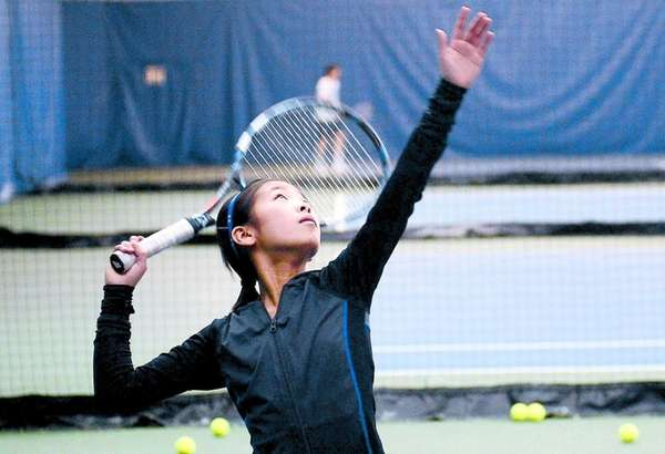 Denise Lai takes a tennis lesson at Sportime