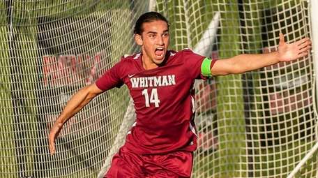 Whitman's Anthony Palazzolo celebrates after scoring the second