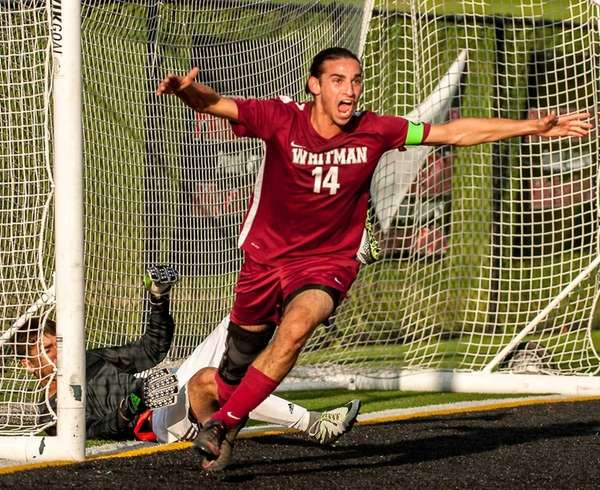 Whitman's Anthony Palazzolo (14) celebrates after scoring the second goal during their game against Half Hollow Hills East at Half Hollow Hills East High School on Thursday, Oct. 13, 2016.