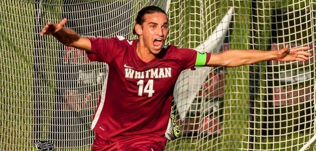 Whitman's Anthony Palazzolo (14) celebrates after scoring the