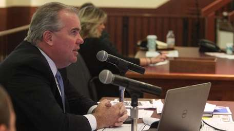 Acting Nassau Police Commissioner Thomas Krumpter offers testimony