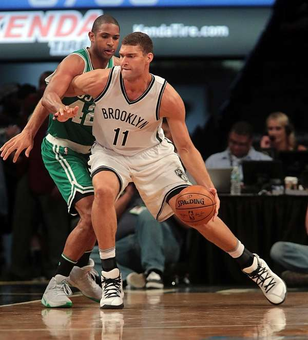 Brooklyn Nets center Brook Lopez (11) drives against