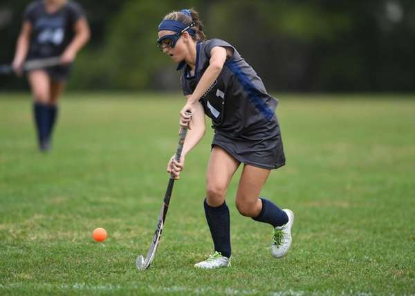 Eastport-South Manor's Emily Masera (11) dribbles the ball