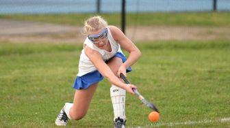 Riverhead's Shannon Schmidt (12) takes a corner shot