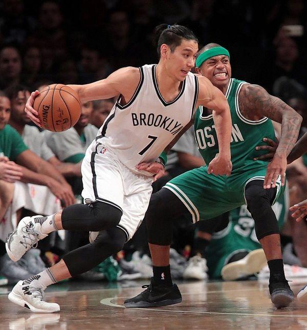 Brooklyn Nets guard Jeremy Lin drives against Boston