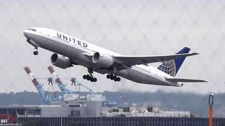 A United Airlines plane takes off from Newark