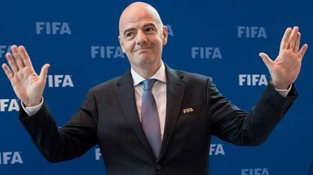 FIFA President Gianni Infantino gestures during the press