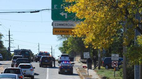New York State Police investigate the scene where