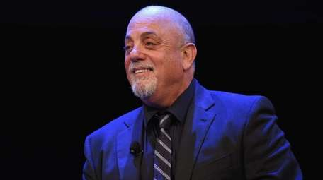 Musician Billy Joel speaks onstage at the New