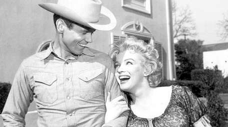Don Murray with Marilyn Monroe in