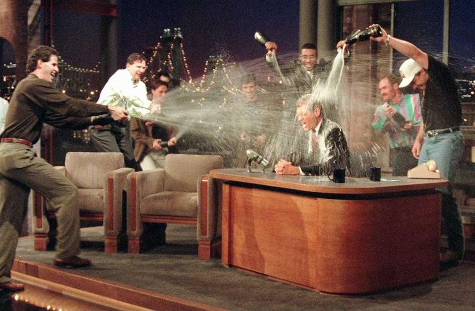David Letterman gets a champagne bath from members