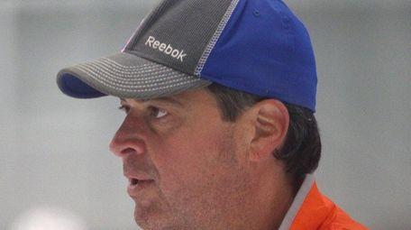 New York Islanders coach Jack Capuano looks on