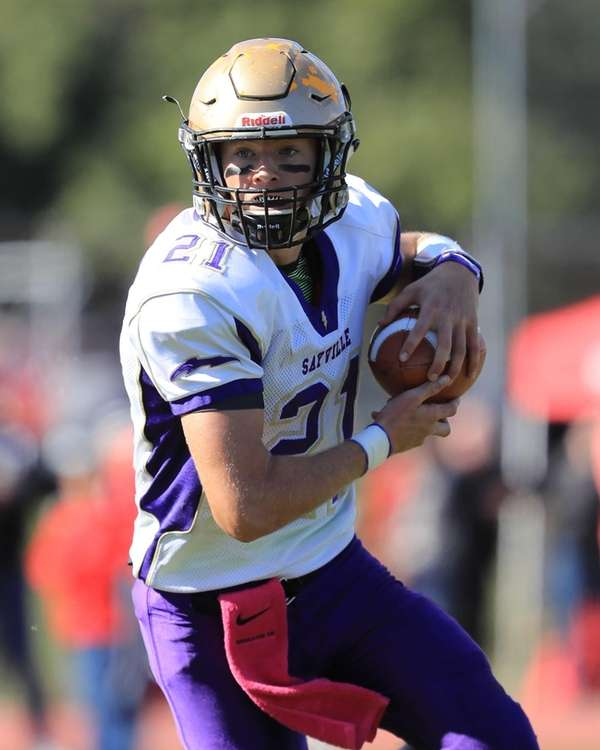 Sayville running back Ashton Bradley breaks through the