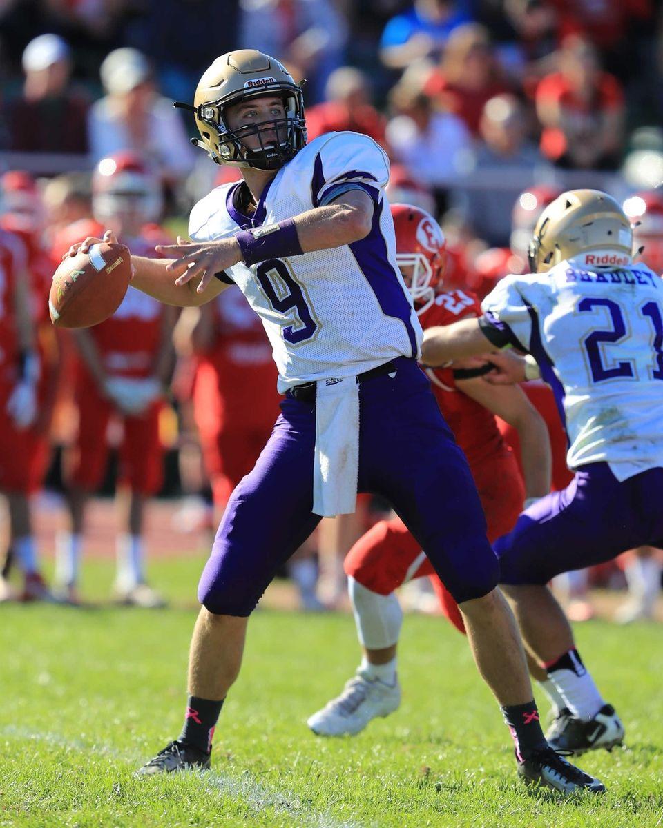 Sayville quarterback Jack Coan #9 drops back to