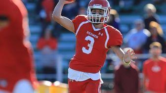 East Islip quarterback Kyle Fleitman #3 throws a
