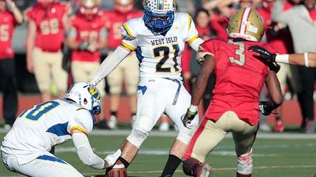 As West Islip's Kevin Cunningham (10) holds, Kevin