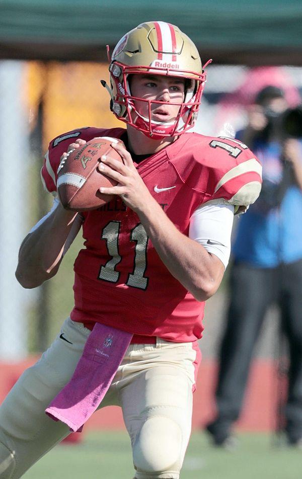 Hills West quarterback Gerald Filardi (11) steps into
