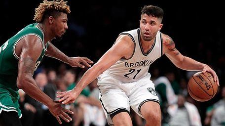 Brooklyn Nets guard Greivis Vasquez drives against Boston
