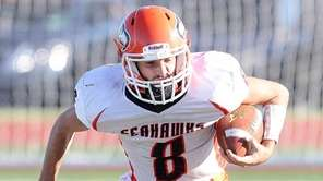 Carey's Dan Conte (8) runs the ball and