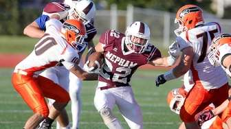 Mepham's Michael Valentino (22) runs for a first