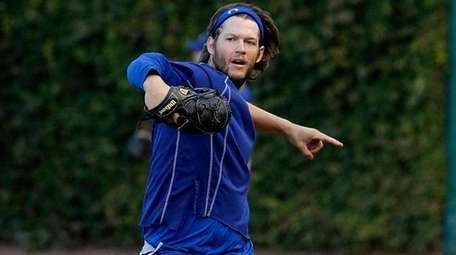 Los Angeles Dodgers' Clayton Kershaw warms up during