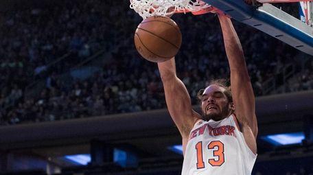 New York Knicks' center Joakim Noah dunks during