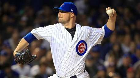 Chicago Cubs starting pitcher Jon Lester winds up