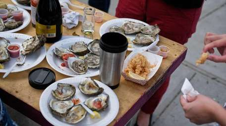 Crowds gather to enjoy fresh oysters during the