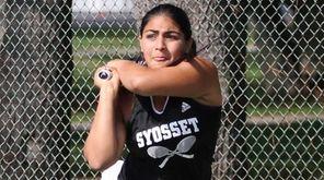 Risha Malhotra of Syosset returns a shot to