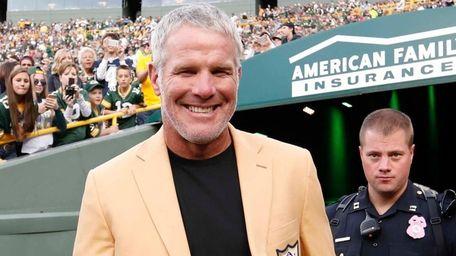 Former Green Bay Packers' Brett Favre smiles as