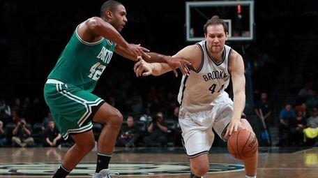 Bojan Bogdanovic of the Brooklyn Nets drives