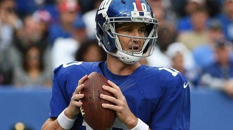 New York Giants quarterback Eli Manning threw for