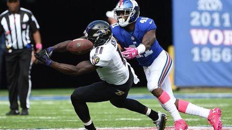 New York Giants cornerback Dominique Rodgers-Cromartie breaks up