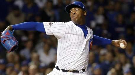 Chicago Cubs relief pitcher Aroldis Chapman throws during