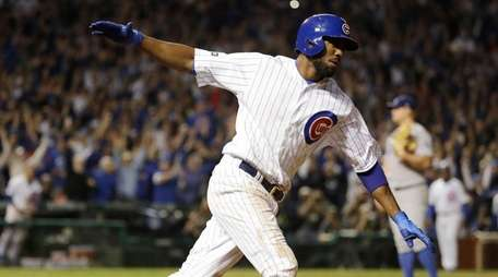 Chicago Cubs' Dexter Fowler runs the bases after