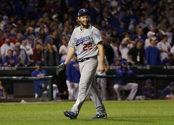 Los Angeles Dodgers starting pitcher Clayton Kershaw reacts