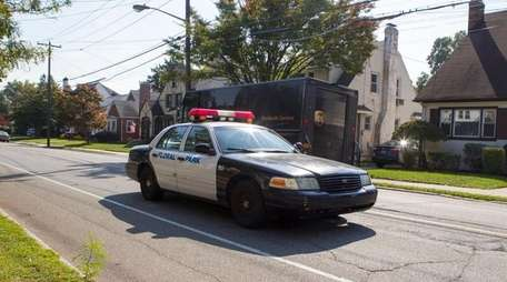 Floral Park police patrol on Tulip Avenue on