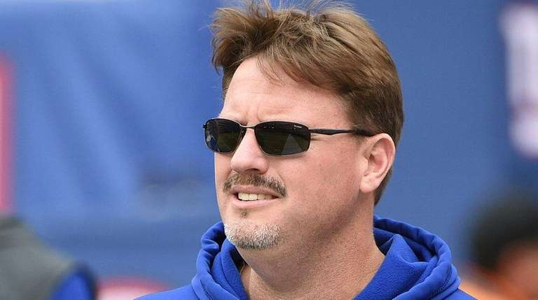 New York Giants head coach Ben McAdoo walks