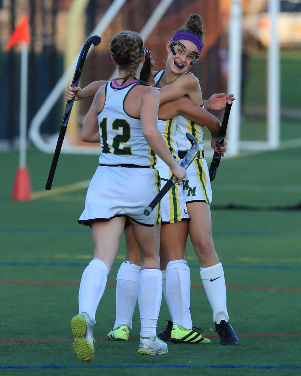 Ward Melville teammates congratulate Kate Mulham #4 after
