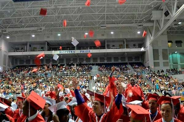 Freeport High School graduates throw their mortarboards into