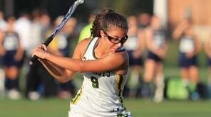 Lexi Reinhardt takes a shot during Ward Melville's